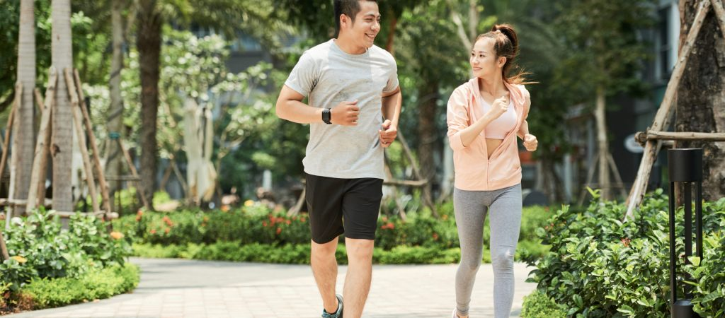 Vietnamese,Man,And,Woman,Jogging,Together,In,The,Park